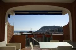 Porto Ercole – Elegante appartamento con splendida vista mare e terrazzo coperto, a pochi metri dal porto. Garage