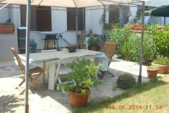 Vendita appartamento di recente costruzione con terrazzo e giardino. Garage. Porto Ercole